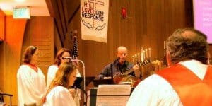 Music leaders lead the congregation playing keyboard and guitar