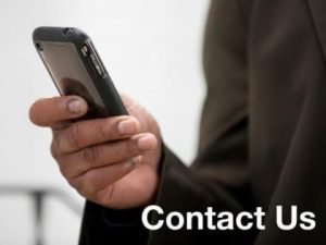 "Photo of a cell phone in a man's hand and the words ""Contact Us"""