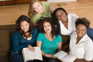 Photo of 4 women with bibles open