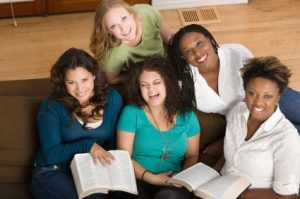 Photo of 5 women with a couple of open bibles.