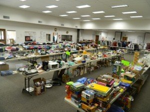 Photo of tables covered with items for sale in the annual yard in Mt Olive's Fellowship Hall