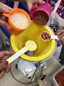 Each of the ingredients is shown in different size measuring cups over z yellow funnel