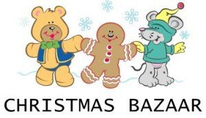 Stuffed animals holding hands in Christmas sweaters