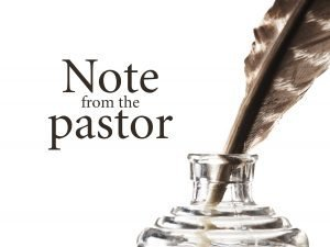 "Photo of a feather quill in an ink jar with the words, ""Note from the Pastor."""