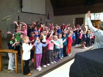 Photo of Preschool children in the sanctuary of the church singing.