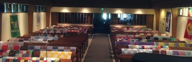 Quilts arrayed to be blessed.