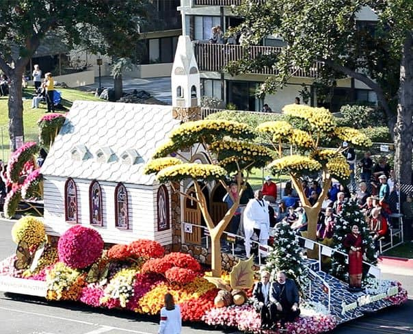 Flower covered float in the shape of a church.