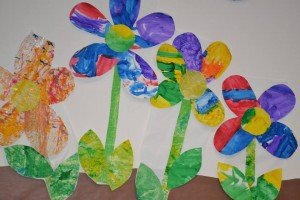 Photo of flowers made of paper and paint decorating the fellowship hall