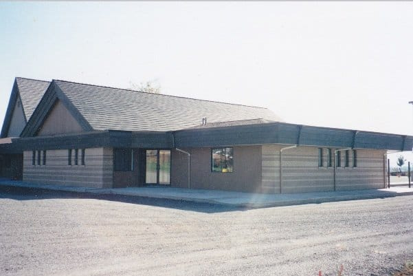 Photo of the west wing showing the NW entrance with gravel parking lot