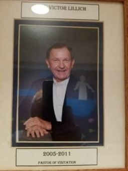 Photo of a framed picture of a man with a white shirt and jacket