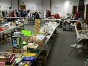 Photo of tables covered with items for sale in the Fellowship Hall