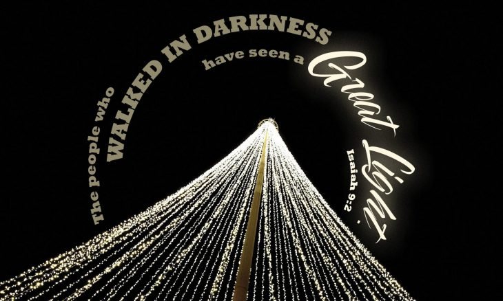 """Photo of strings of lights on a black background with the words, """"The people who walked in darkness have seen a great light."""""""