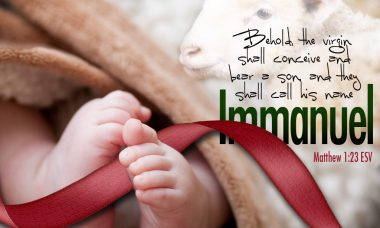 """Photo of baby feet with a red ribbon and the words, """"Behold the virgin shall conceive and bear a son, and they shall call his name Immanuel."""""""