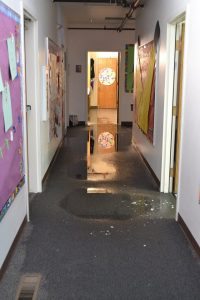 School hallway with puddles on the carpet