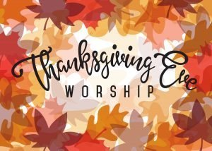 """The words, """"Thanksgiving Eve Worship"""" on background of colorful leaves."""