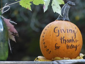 """Photo of a Pumpkin with the words """"Giving thanks for today"""" written on it with black marker"""
