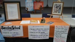 Table set up with posters about Sunday School.