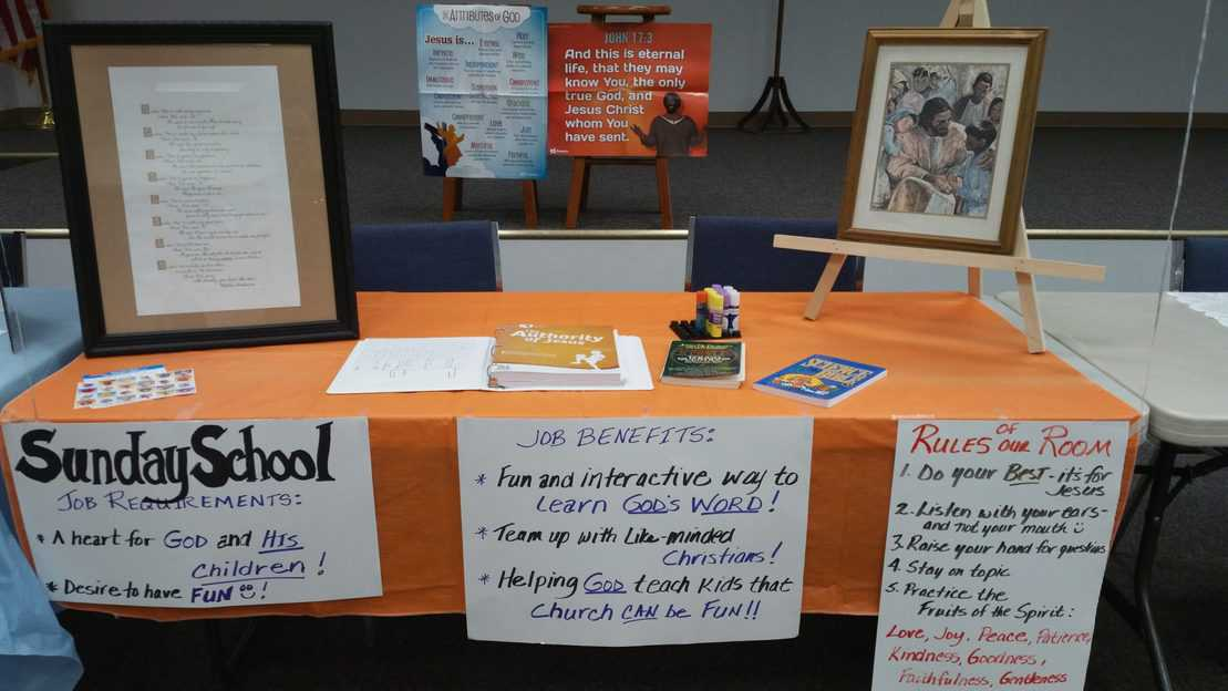 Table set up with posters for Sunday School