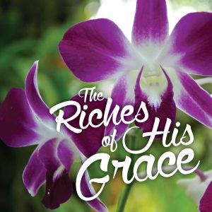 """Photo of purple orchids with the words, """"The Riches of His Grace."""""""