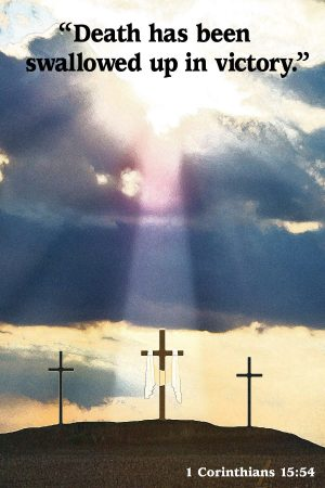 "A photo of the sun shining through clouds over three crosses and the words, ""Death has been swallowed up in victory."""