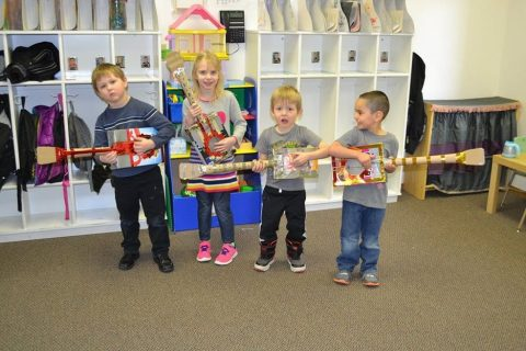 Four small children with musical instruments in a Mt Olive preschool classroom