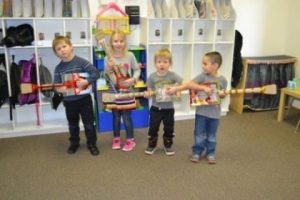 Four small children with home made musical instruments in a Mt Olive preschool classroom