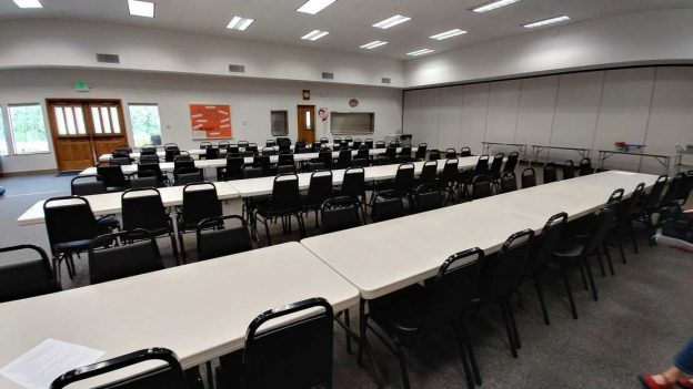 Photo of Fellowship Hall with new chairs at the tables