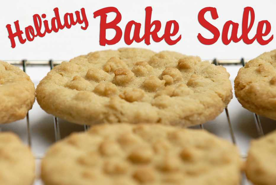 """Cookies with a criss-cross pattern on a cooling rack with the words """"Holiday Bake Sale."""""""