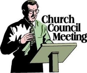 "Man standing behind a podium with the words ""Church Council Meeting."""