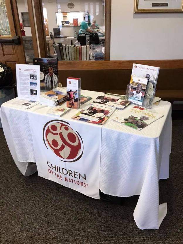 Table with brochures and books about the Children of the Nations organization
