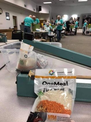 Close-up of one meal in a bag on the sealing table.
