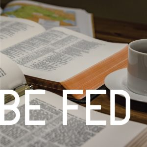 "Photo of a couple of Bibles open beside a coffee cup with the words, ""Be fed."""