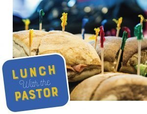 "Photo of sandwiches closeup with a toothpick in each and the words, ""Lunch with the Pastor."""