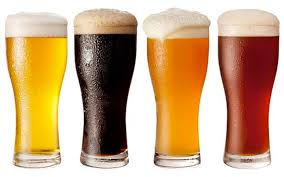 Photo of 4 glasses of different beers.