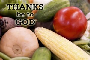 "Photo of vegetables: corn,onion, tomato, cucumber etc. with the words ""Thanks be to God."""