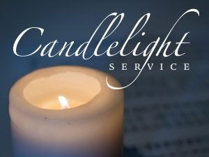 "The words, ""Candlelight Service"" above a photo of a lighted candle."
