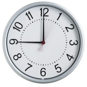 Photo of a clock showing 9:00.