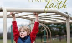 A photo of a boy crossing the monkey bars at a playground with the words