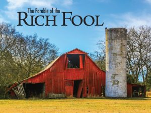 "Photo of a red barn and silo in dilapidated condition with the words ""The Parable of the Rich Fool."""