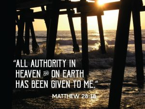 """Photo of sunset from under a pier with the words, """"All authority in heaven and on earth has been given to me."""""""