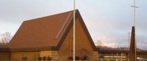 Photo of Mt Olive Lutheran Church with old outline of Jesus kneeling in prayer and the Cross from Tieton Drive background