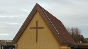 Photo of the A-frame Sanctuary showing the LCMS Cross from Tieton Drive.