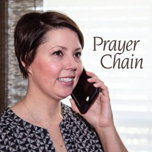 "The words, ""Prayer Chain"" on a photo of a woman holding a cell phone to her ear."