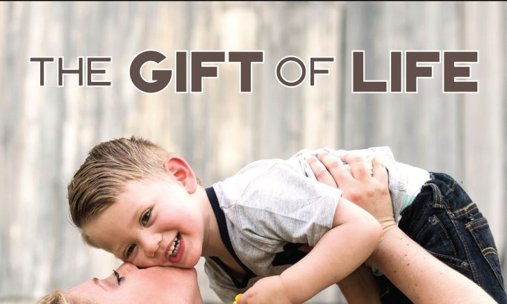 "Photo of a woman holding a small boy above her and kissing him on the cheek with the words, ""The gift of life."""