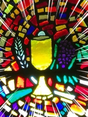 Photo of a stained glass window portraying an image of a chalice.