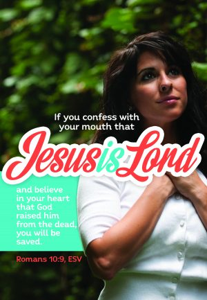 "Photo of a woman whose hands are folded on her chest with the words ""Jesus is Lord"" in large letters."
