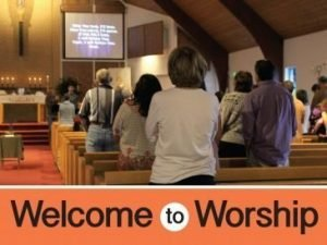 "The words, ""Welcome to Worship"" below a photo of a sanctuary similar to Mt. Olive's."