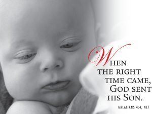 """Close-up photo of a baby with the words, """"When the right time came God sent his Son."""""""