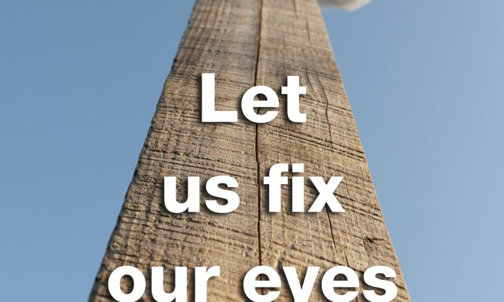 "Photo of a cross from the bottom with the words, ""Let us fix our eyes on Jesus."""