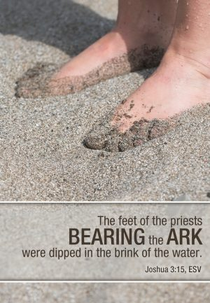 Photo of two bare feet in wet sand with the words of Joshua 3:15.